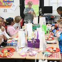 Lauren Wood   Buy at photos.djournal.com<br /> Students eat their snacks during the Valentine's Day party Friday afternoon in Carol Elliott's first grade classroom.