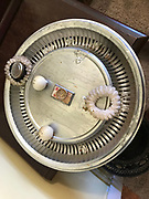 Silver hub cap from back of bus 16 in diameter hair ties nad bobbers<br />