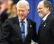 BLACKWOOD, NJ - JANUARY 29: Former U.S. President Bill Clinton is greeted by New Jersey Governor Jon Corzine (R) before speaking at a campaign rally for his wife, Democratic Presidential candidate Sen. Hillary Rodham Clinton at Camden County College January 29, 2008 in Blackwood, New Jersey. Hundreds atended the rally in support of Mrs. Clinton. (Photo by William Thomas Cain/Getty Images)