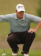 Michael Harris eyes his birdie putt on the 18th hole of teh Alpine course on his way to winning the 2006 Tournament of Champions at Boyne Mountain.