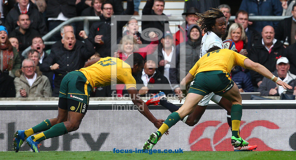 Picture by Paul Terry/Focus Images Ltd +44 7545 642257<br /> 02/11/2013<br /> Marland Yarde of England breaks past Adam Ashley-cooper ( C ) and Tevita Kuridrani of Australia during the QBE Internationals  match at Twickenham Stadium, Twickenham.
