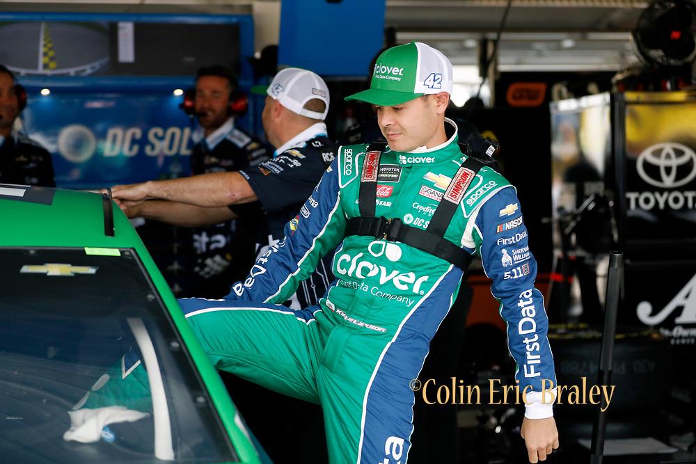 NASCAR Cup Series driver Kyle Larson prepares for a practice run at Kansas Speedway in Kansas City, Kan., Friday, May 11, 2018. (AP Photo/Colin E. Braley)