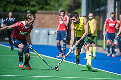 Australia's Russell Ford is shadowed by Barry Middleton of England. England v Australia, Bisham Abbey, Marlow, UK on 25 May 2014. Photo: Simon Parker