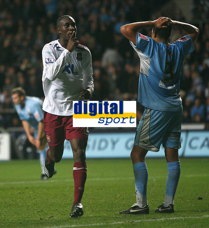 Photo: Steve Bond.<br /> Coventry City v West Ham United. Carling Cup. 30/10/2007. Carlton Cole (L) celebrates. Marcus Hall (R) looks dejected