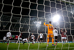 West Ham United's Javier Hernandez (right) celebrates scoring his side's first goal of the game during the Premier League match at London Stadium.