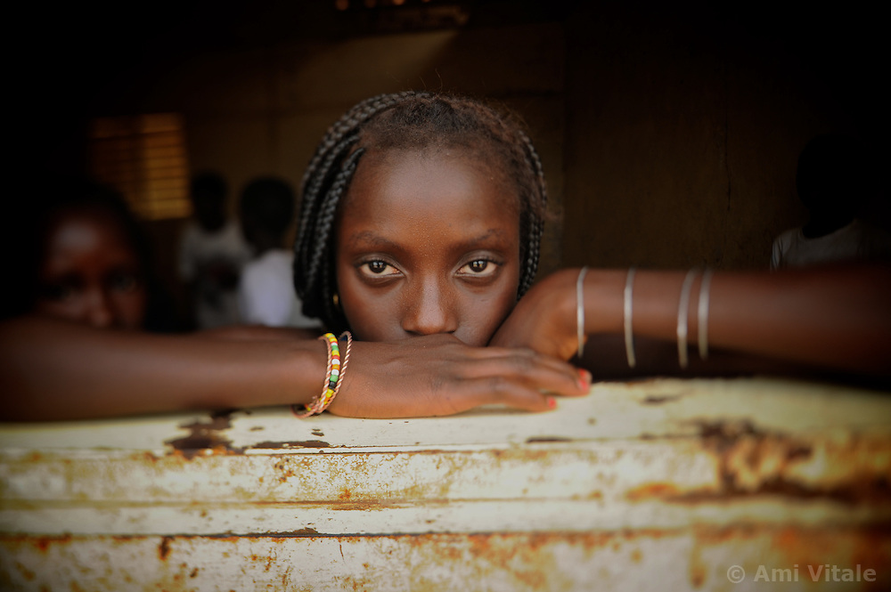 Jenabu Balde rests her head inside the school in the remote village of Dembel Jumpora in Guinea Bissua.  Most men coming from this conservative Muslim village of Fulani's believe the girls should stay at home and work.