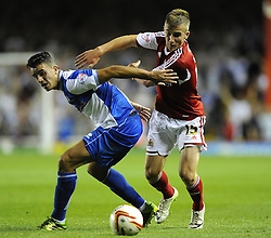 Bristol City's Joe Bryan battles for the ball with Bristol Rovers' Oliver Norburn  - Photo mandatory by-line: Joe Meredith/JMP - Tel: Mobile: 07966 386802 04/09/2013 - SPORT - FOOTBALL -  Ashton Gate - Bristol - Bristol City V Bristol Rovers - Johnstone Paint Trophy - First Round - Bristol Derby