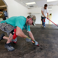 Thomas Wells | BUY at PHOTOS.DJOURNAL.COM<br /> Darrell Haywood, left, and John Seidl remove theglue from the floor before a new floor can be put down at Our Artworks on West Jackson iin Tupelo.