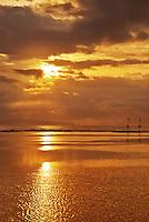 Breathtaking golden sunrise over the sea in Bali, Indonesia.