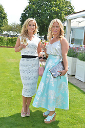 Left to right, HEIDI RANGE and her sister HAYLEY RANGE at the Audi International Polo at Guards Polo Club, Windsor Great Park, Egham, Surrey on 26th July 2014.