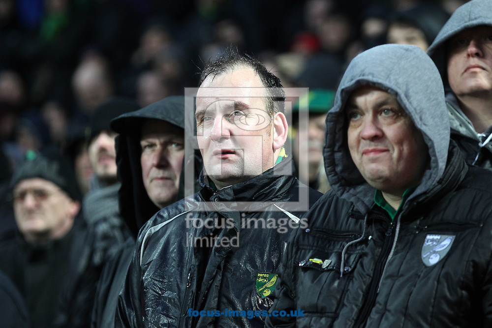 The traveling Norwich fans look dejected after their side concedes a 2nd goal during the Barclays Premier League match at Villa Park, Birmingham<br /> Picture by Paul Chesterton/Focus Images Ltd +44 7904 640267<br /> 06/02/2016