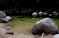 A swimmer takes a dip in the popular swimming home in Mossman Gorge, the Daintree National park.