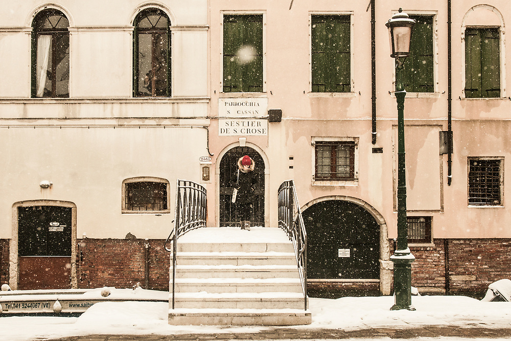 VENICE, ITALY - 28th FEBRUARY/01st MARCH 2018<br /> A girl exits from her house during a snowfall in Venice, Italy. A blast of freezing weather called the &ldquo;Beast from the East&rdquo; has gripped most of Europe in the middle of winter of 2018, and in Venice A snowfall has covered the city with white, making it fascinating and poetic for citizen and tourists.   &copy; Simone Padovani / Awakening