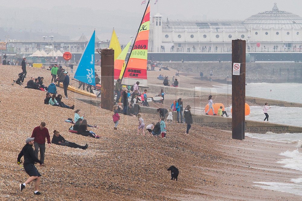 **DATE CORRECTION, Pictures were taken today 15/04/2018**<br /> &copy; Licensed to London News Pictures. 15/04/2018. Brighton, UK. only a handful of people can be seen on the beach in Brighton and Hove as cold and grey weather is hitting the seaside resort. Photo credit: Hugo Michiels/LNP