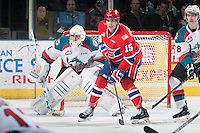 KELOWNA, CANADA - MARCH 7: Devon McAndrews #15 of Spokane Chiefs looks for the pass in front of the net of Jackson Whistle #1 of Kelowna Rockets on March 7, 2015 at Prospera Place in Kelowna, British Columbia, Canada.  (Photo by Marissa Baecker/Shoot the Breeze)  *** Local Caption *** Jackson Whistle; Devon McAndrews;