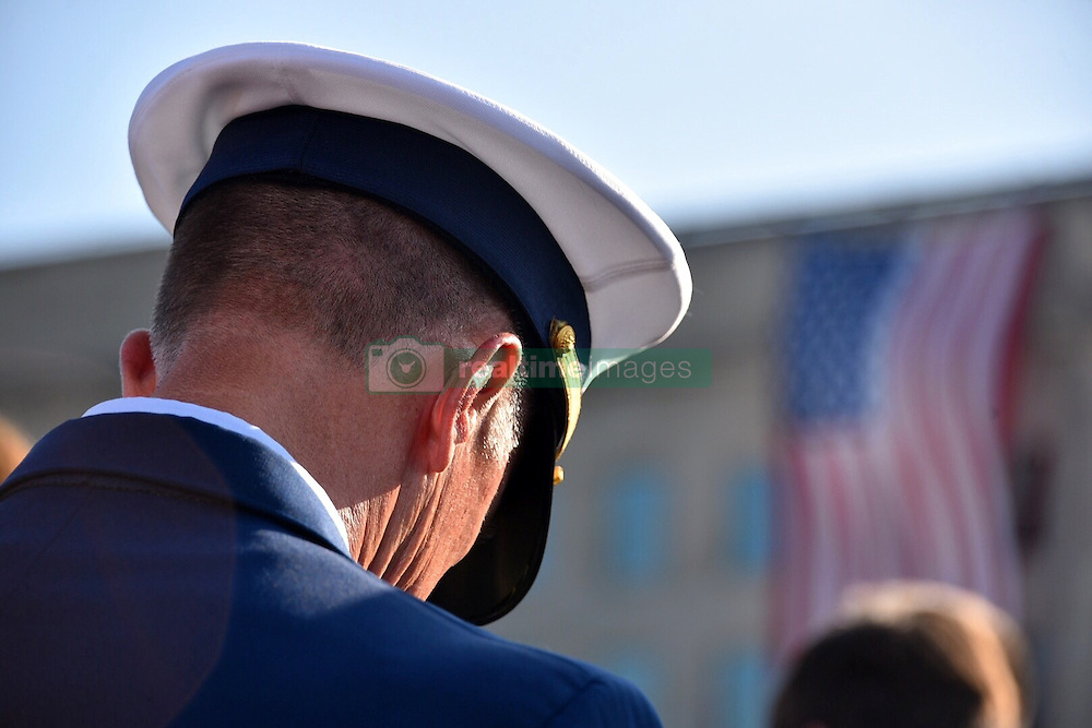 September 11, 2016 - Arlington, United States of America - Coast Guard Commandant Adm. Paul Zukunft bows his head during a ceremony commemorating the 15th anniversary of the 9/11 terrorist attacks at the Pentagon September 11, 2016 in Arlington, Virginia. (Credit Image: © Po2 Patrick Kelley/Planet Pix via ZUMA Wire)