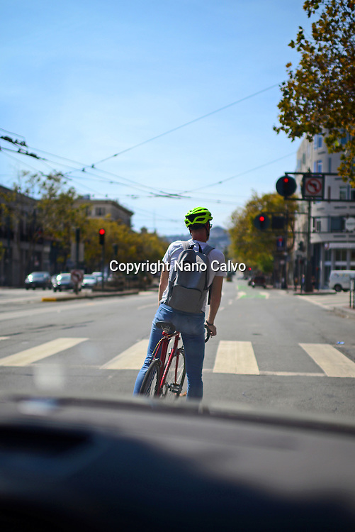Bicycle rider viewed from inside car, San Francisco.