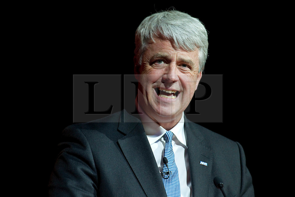 © Licensed to London News Pictures. 20/06/2012. Manchester , UK . Andrew Lansley addresses the NHS Confederation Annual Conference at Manchester Central , in Manchester . During his speech , the Health Secretary called on doctors to call off their planned strike tomorrow (Thursday 21st). Photo credit : Joel Goodman/LNP