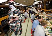 "Customers enjoy dinner aboard a ""Yakata-bune"" pleasure boat run by the Yasuda family in Tokyo, Japan on 30 August  2010. Photographer: Robert Gilhooly"