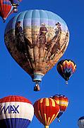Hot air balloons rising in morning light at the International Balloon Fiesta, Albuquerque, New Mexico
