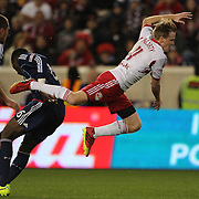 Dax McCarty, New York Red Bulls, is sents flying by a tackle from Jalil Anibaba, Chicago Fire, during the New York Red Bulls V Chicago Fire, Major League Soccer regular season match at Red Bull Arena, Harrison, New Jersey. USA. 27th October 2013. Photo Tim Clayton