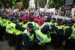 "© Licensed to London News Pictures . 11/06/2017 . Manchester , UK .  Demonstration against Islamic hate , organised by former EDL leader Tommy Robinson's "" UK Against Hate "" and opposed by a counter demonstration of anti-fascist groups . UK Against Hate say their silent march from Piccadilly Train Station to a rally in Piccadilly Gardens in central Manchester is in response to a terrorist attack at an Ariana Grande concert in Manchester , and is on the anniversary of the gun massacre at the Pulse nightclub in Orlando . Photo credit: Joel Goodman/LNP"