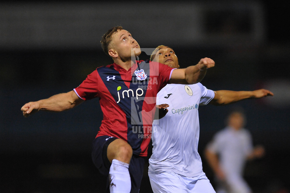 TELFORD COPYRIGHT MIKE SHERIDAN Marcus Dinanga of Telford battles for the ball with Kallum Griffiths during the Vanarama Conference North fixture between AFC Telford United and York City at Bootham Crescent on Saturday, January 11, 2020.<br /> <br /> Picture credit: Mike Sheridan/Ultrapress<br /> <br /> MS201920-040