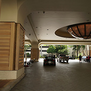 Wood panels covering columns in the valet area of the main entrance to the casino.<br /> Lots of pedestrian traffic..