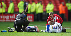 SHEFFIELD, ENGLAND - Saturday, March 17, 2012: Sheffield United and Tranmere Rovers physios treat two injured Tranmere players during the Football League One match at Bramall Lane. (Pic by David Rawcliffe/Propaganda)