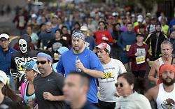 October 21, 2018 - U.S. - SPORTS -- Runners fill up 3rd Street as the start of the half-marathon during the Duke City Martathon on Sunday, October 21. (Credit Image: © Greg Sorber/Albuquerque Journal via ZUMA Wire)