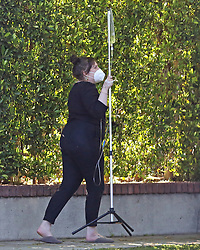 EXCLUSIVE: Actress Lena Dunham takes a 34th birthday stroll - carrying an IV pack. Exactly why the Girls star was hooked up to the drip is unknown. But vitamin drips have been used by some to boost energy, assist with other common maladies - and cure hangovers. However medical professionals have harshly criticized the practice, popular among celebrities, as a snake oil treatment. Lena celebrated her birthday during lockdown at her home in Los Angeles.The actress posted Instagram pix showing how she made the most of her day by lounging in the sun beside her swimming pool, as she soaked up the rays in her garden. At one point she walked out from the house, wearing a face mask and clutching the IV drip, to chat to a friend. Lena starred with Brad Pitt and Leonardo Dicaprio, along with a host of other stars in the Quentin Tarantino movie Once Upon a Time in Hollywood. 13 May 2020 Pictured: Lena Dunham. Photo credit: P&P / MEGA TheMegaAgency.com +1 888 505 6342