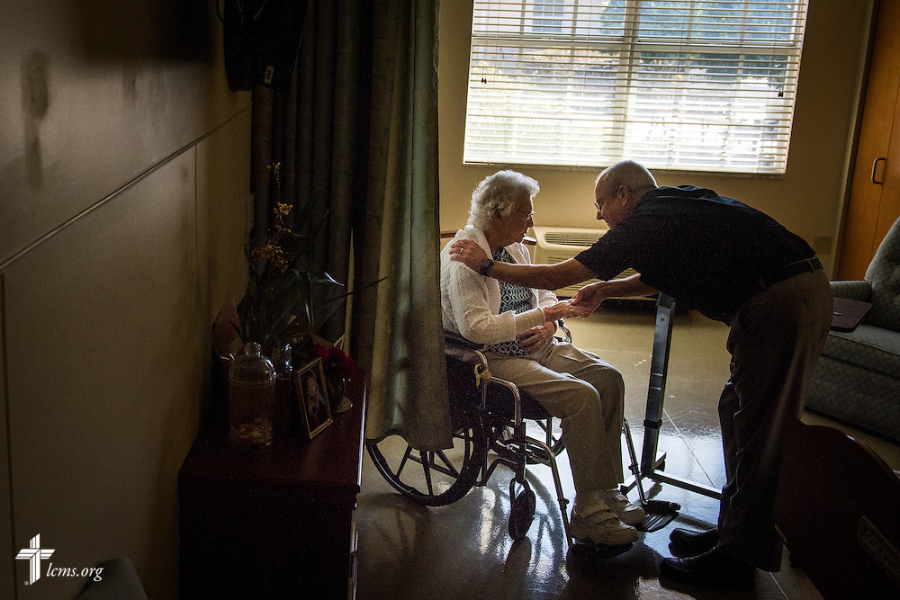 The Rev. Wally Arp, senior pastor at St. Luke's Lutheran Church, visits a parishioner at the Lutheran Haven on Monday, March 7, 2016, in Oviedo, Fla. LCMS Communications/Erik M. Lunsford
