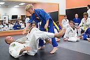 Royce Gracie and Wyatt Gouger during a jiu-jitsu lesson at US Blackbelt Academy on Thursday, March 26, 2015 in Laguna Niguel, Calif. (Photo/Josh Barber)