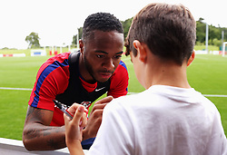 England's Raheem Sterling signs an autograph for a fan - Mandatory by-line: Matt McNulty/JMP - 29/08/2017 - FOOTBALL - St George's Park National Football Centre - Burton-upon-Trent, England - England Training and Press Conference