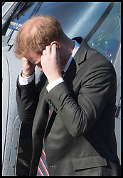 September 13, 2018 - Lympstone, United Kingdom - Image licensed to i-Images Picture Agency. 12/09/2018. Lympstone , United Kingdom. Prince Harry, The Duke of Sussex removes his ear plugs after arriving by helicopter for a visit at  the Royal Marines Commando Training Centre in Lympstone, Devon, United kingdom,  for the first time in his role as Captain General Royal Marines. (Credit Image: © Stephen Lock/i-Images via ZUMA Press)