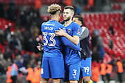 AFC Wimbledon striker Lyle Taylor (33) and AFC Wimbledon defender Jon Meades (3) hugging after game during the The FA Cup 3rd round match between Tottenham Hotspur and AFC Wimbledon at Wembley Stadium, London, England on 7 January 2018. Photo by Matthew Redman.