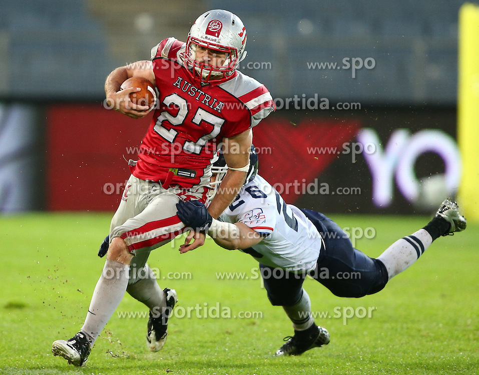 04.06.2014, UPC Arena, Graz, AUT, American Football Europameisterschaft 2014, Gruppe B, Frankreich (FRA) vs Oesterreich (AUT), im Bild Andreas Hofbauer, (Team Austria, RB, #27) und Victor  Ferrier , (Team France, DB , #26) // during the American Football European Championship 2014 group B game between France vs Austria at the UPC Arena, Graz, Austria on 2014/06/04. EXPA Pictures © 2014, PhotoCredit: EXPA/ Thomas Haumer
