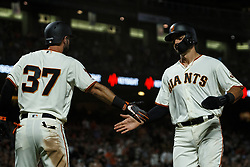 SAN FRANCISCO, CA - AUGUST 13: Aramis Garcia #16 of the San Francisco Giants is congratulated by Joey Rickard #37 after scoring a run against the Oakland Athletics during the seventh inning at Oracle Park on August 13, 2019 in San Francisco, California. The San Francisco Giants defeated the Oakland Athletics 3-2. (Photo by Jason O. Watson/Getty Images) *** Local Caption *** Aramis Garcia; Joey Rickard