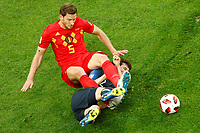SAINT PETERSBURG, RUSSIA - JULY 10: Benjamin Pavard (C) of France national team and Jan Vertonghen of Belgium national team vie for the ball during the 2018 FIFA World Cup Russia Semi Final match between France and Belgium at Saint Petersburg Stadium on July 10, 2018 in Saint Petersburg, Russia. MB Media