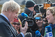 Boris gives his impressions to the TV crews. Gift Horse by Hans Haacke is unveiled by The Mayor of London, Boris Johnson, as the tenth commission for the Fourth Plinth in Trafalgar Square, 5 Mar 2015, London. The sculpture portrays a skeletal, riderless horse – a 'wry' comment on the equestrian statue of William IV originally planned for the plinth. Tied to the horse's front leg is an electronic ribbon displaying live the ticker of the London Stock Exchange, completing the link between power, money and history. The horse is derived from an engraving in the Anatomy of a Horse of 1766 by George Stubbs; the famous English painter whose works are represented in the National Gallery at Trafalgar Square. Hans Haacke is one of Germany's most important contemporary artists, known for his installations in the Reichstag in Berlin, and for taking a sledgehammer to the floor of the German Pavilion at the 1993 Venice Biennale in protest against the building's Nazi-style architecture.