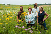 Libertyville Township Supervisor Kathleen O'Conner (second from left) poses in the blossoming Liberty Prairie Nature Reserve, an area of the Bull Creek / Bulls Brook Watershed that she helps to protect with colleagues like )left to right) Township Open Spaces Field Manager Chris Slago, Senior Ecologist Vince Mosca of Hey & Associates Inc. and Outreach Manager Susan Surroz of the Liberty Prairie Conservancy. Projects like the management of the Bulls Brook stream buffer at Casey Farm and the land and water restoration at the Liberty Prairie Preserve have earned the Township the 2010 Community of the Year award from the Lake County Stormwater Management Commission.