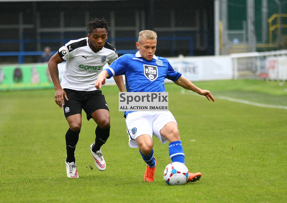 Maccelfields midfeilder Lindon Meikle keeps the ball from Dover's midfielder Toby Ajala (12). Dover Athletic against Macclesfield Town in the Vanorama Conference Premier. At Crabble Stadium, Dover, Kent. (c) Matt Bristow | SportPix.org.uk