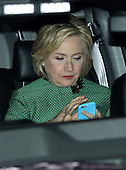 Hillary Clinton using her iphone
