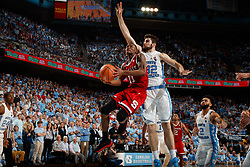 CHAPEL HILL, NC - JANUARY 27: Markell Johnson #11 of the North Carolina State Wolfpack is pressured by Luke Maye #32 of the North Carolina Tar Heels on January 27, 2018 at the Dean Smith Center in Chapel Hill, North Carolina. North Carolina lost 95-91. (Photo by Peyton Williams/UNC/Getty Images) *** Local Caption *** Markell Johnson;Luke Maye