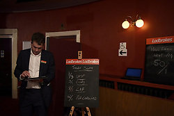 "© London News Pictures. ""Looking for Nigel"". A body of work by photographer Mary Turner, studying UKIP leader Nigel Farage and his followers throughout the 2015 election campaign. PICTURE SHOWS - The election odds are written up on blackboards at the UKIP Spring Conference at the Winter Gardens theatre in Margate, Kent, on February 27th 2015. Photograph by Mary Turner . Photo credit: Mary Turner/LNP **PLEASE CALL TO ARRANGE FEE** **More images available on request**"