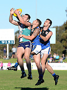 WAFL Elimination Final - Peel Thunder v East Perth Royals at Bendigo Bank Stadium, Mandurah. Photo by Daniel Wilkins. PICTURED- Peel's Michael Apeness flies for a mark opposed to two East Perth defenders.