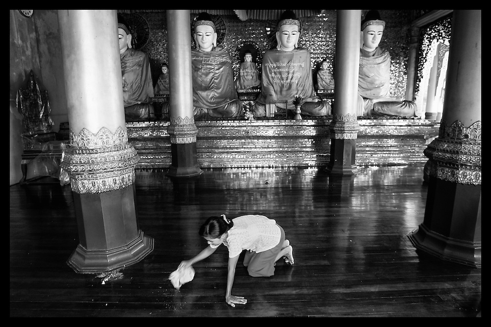 A Burmese woman cleans at the Swedagon Pagoda in Rangoon.