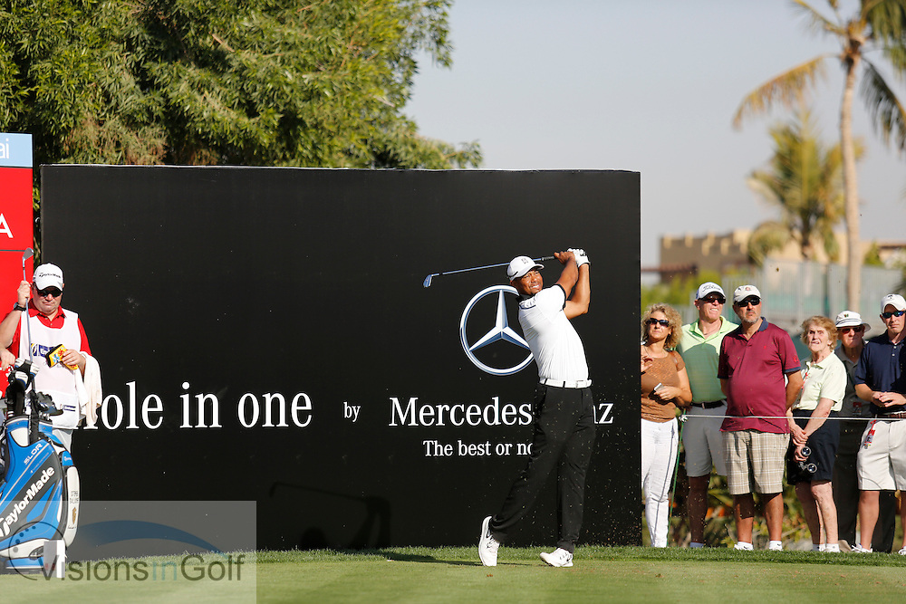 Tiger Woods  advertising boards on the tee Mercedes<br /> Omega Dubai Desert Classic, Emirates GC, UAE, January 2014<br /> Picture Credit:  Mark Newcombe / www.visionsingolf.com