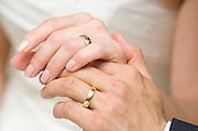 Wedding rings on hands of bride and groom by Cayman Islands photographer Courtney Platt, Grand Cayman