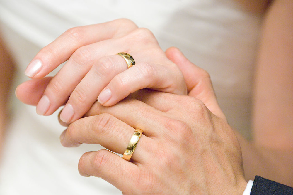 Wedding rings on hands of bride and groom by Cayman Islands photographer Courtney Platt, Grand Cayman